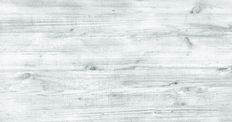 Light white wash soft wood texture surface as background. Grunge whitewashed wooden planks table pattern top view. Light white wash soft wood texture surface as royalty free stock images
