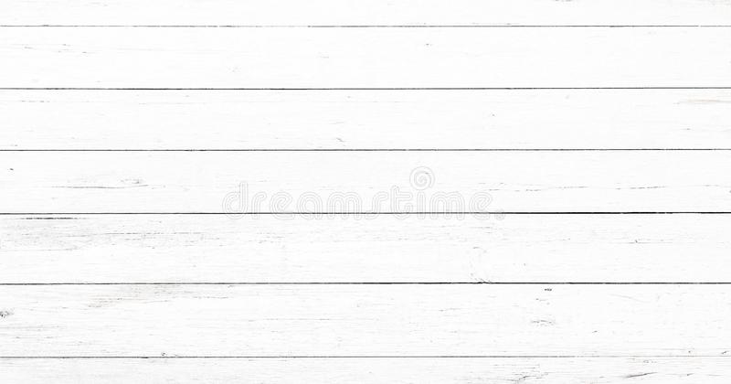 Light white wash soft wood texture surface as background. Grunge whitewashed wooden planks table pattern top view. Light white wash soft wood texture surface as