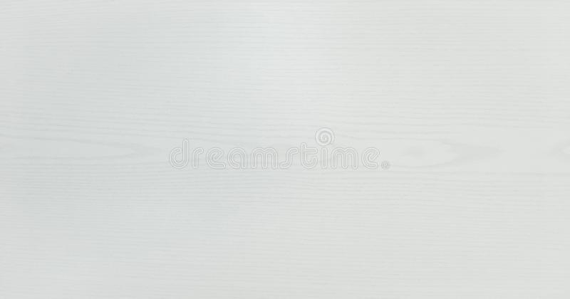 Light white washed soft wood texture surface as background. Grunge whitewashed varnished wooden planks table pattern top view. royalty free stock photos