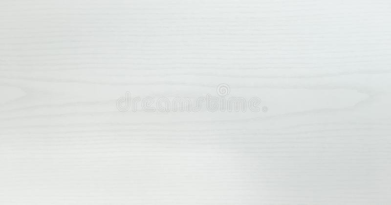Light white washed soft wood texture surface as background. Grunge whitewashed varnished wooden planks table pattern top view. Light white washed soft wood stock photos
