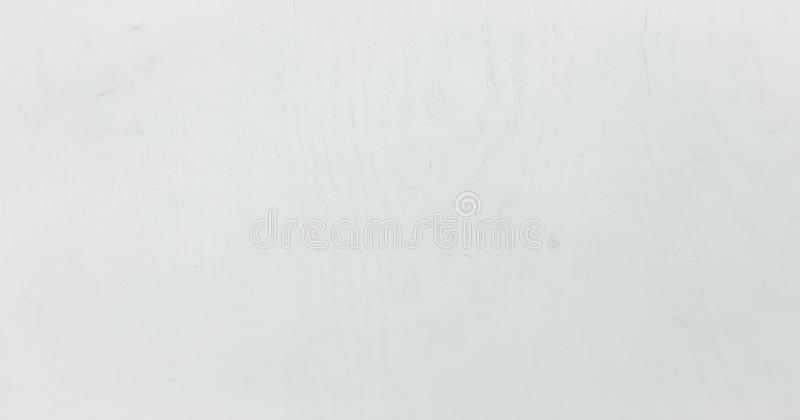 Light white washed soft wood texture surface as background. Grunge whitewashed varnished wooden planks table pattern top view. royalty free stock image