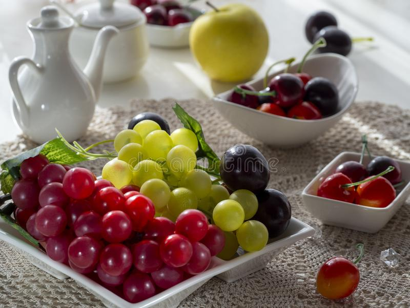 The light from the window falls beautifully on the fruit platter stock images