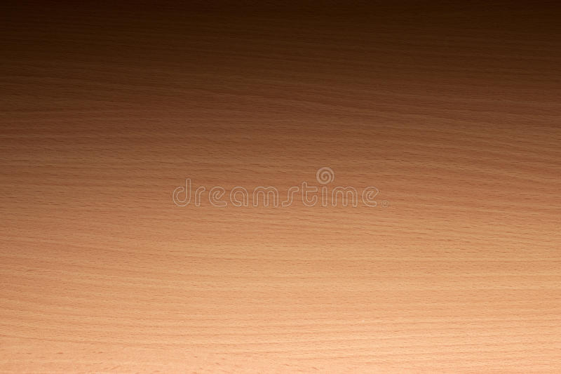 Light Wood Background. A light coloured wood background with horizontal grain. Photographed from a low angle with gradated lighting from light to dark