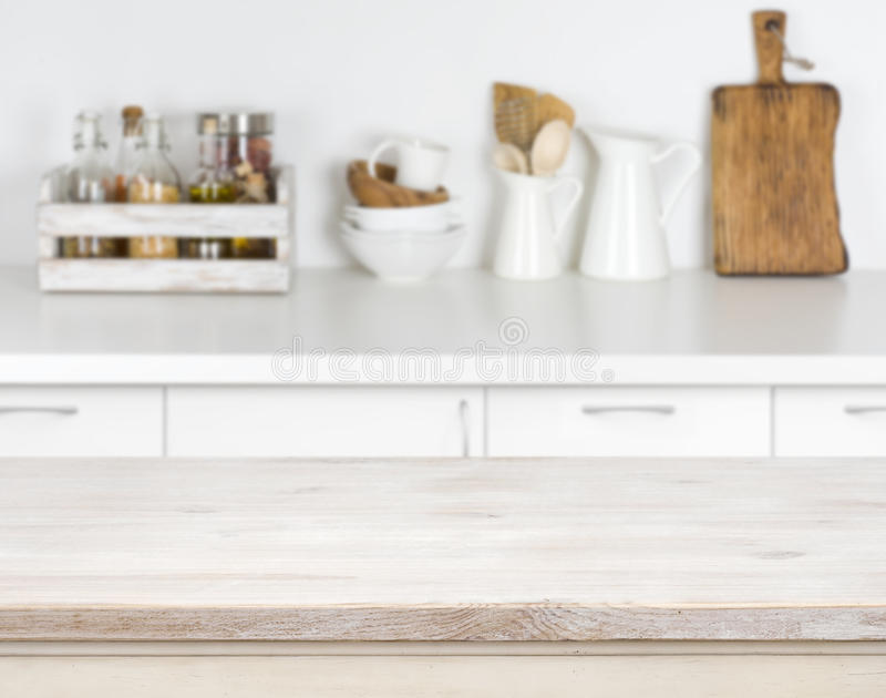 Light wood table with bokeh image of kitchen counter interior royalty free stock photography