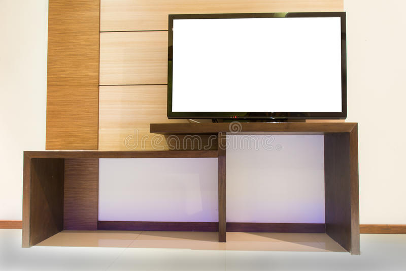 Light wooden TV cabinet with blank white TV in room interior.  stock illustration