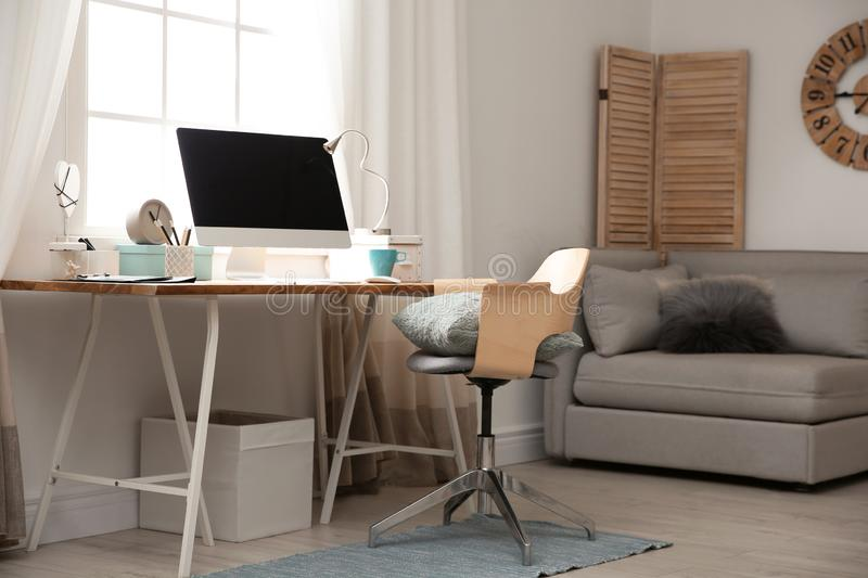 Light work place with computer near window at home. Interior stock image