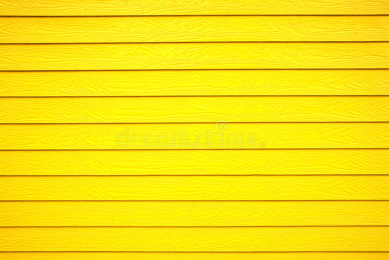 Light yellow color wooden texture background. Light yellow color wooden texture wall background stock image