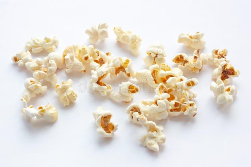 Light yellow fresh salted popcorn on white background. Close up food photography. Light yellow fresh salted popcorn on white background. Close up food stock photo