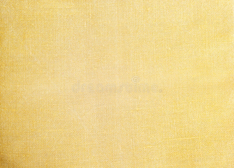 Light yellow natural linen texture for the background royalty free stock photography