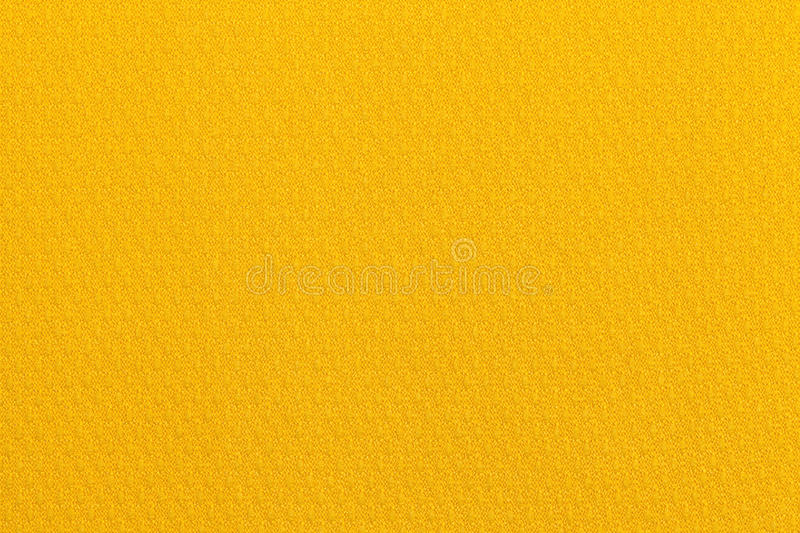 Light yellow ocher background from a textile material. Fabric with natural texture. Backdrop. stock photography