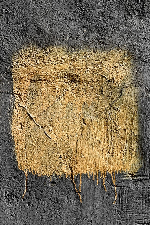 Light yellow square with peeling paint on a flat concrete wall. Grunge texture royalty free stock photos