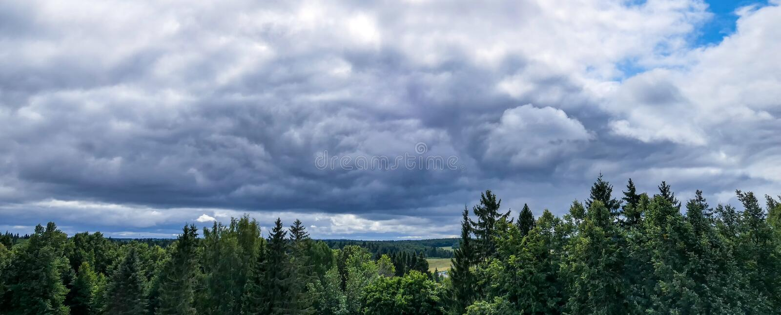 Lightbold dramatic rain clouds. Over countryside royalty free stock photos