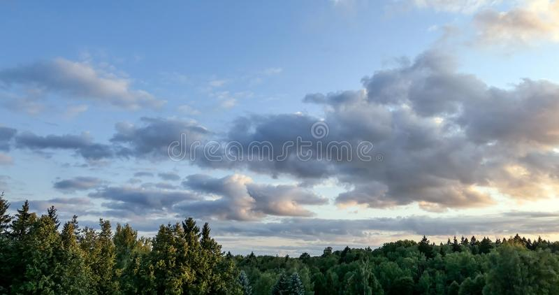 Lightbold dramatic rain clouds. Over countryside stock photo