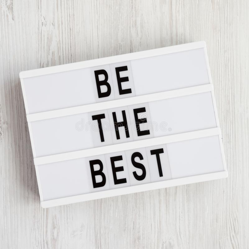 Lightbox with `Be the best` words on a white wooden background. Flat lay, overhead, top view, from above stock photo