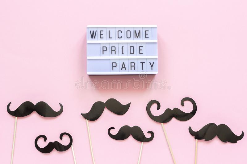 Lightbox text Welcome pride party and paper mustache props on pink background. Concept Homosexuality gay love National. Day Against Homophobia or International royalty free stock photo