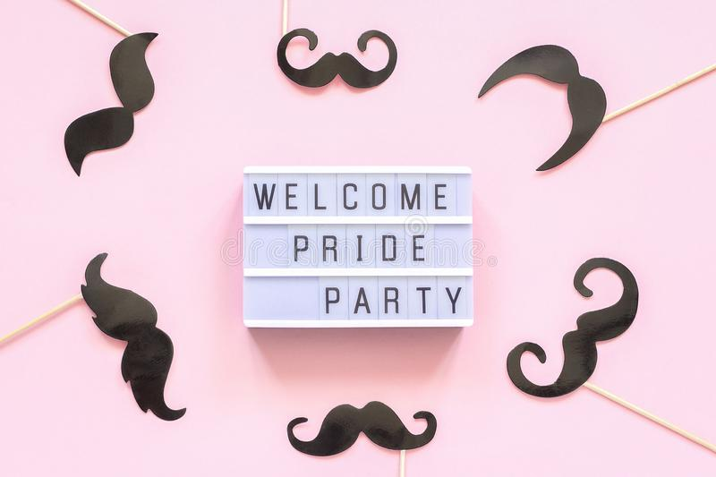 Lightbox text Welcome pride party and paper mustache props on pink background. Concept Homosexuality gay love National. Day Against Homophobia or International royalty free stock photography