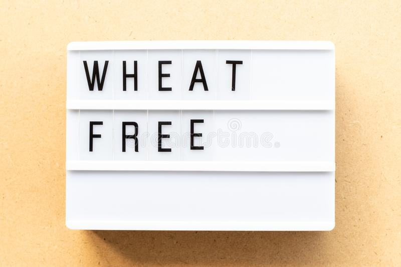 Lightbox with word wheat free on wood background. Light box with word wheat free on wood background royalty free stock photo