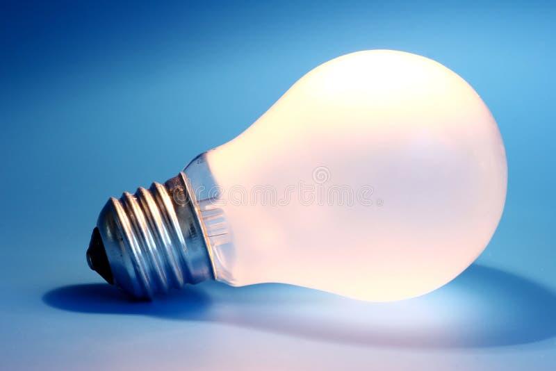 Lightbulb. On blue background royalty free stock images