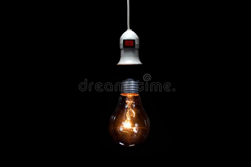 Lightbulb on black background,ideas thinking concept and save energy royalty free stock photography