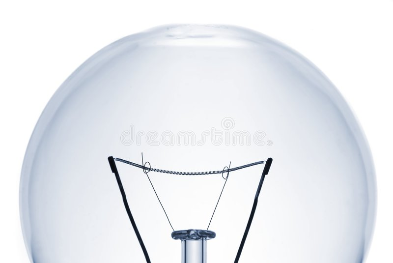 Lightbulb close-up. Close-up of a lightbulb isolated over white stock image