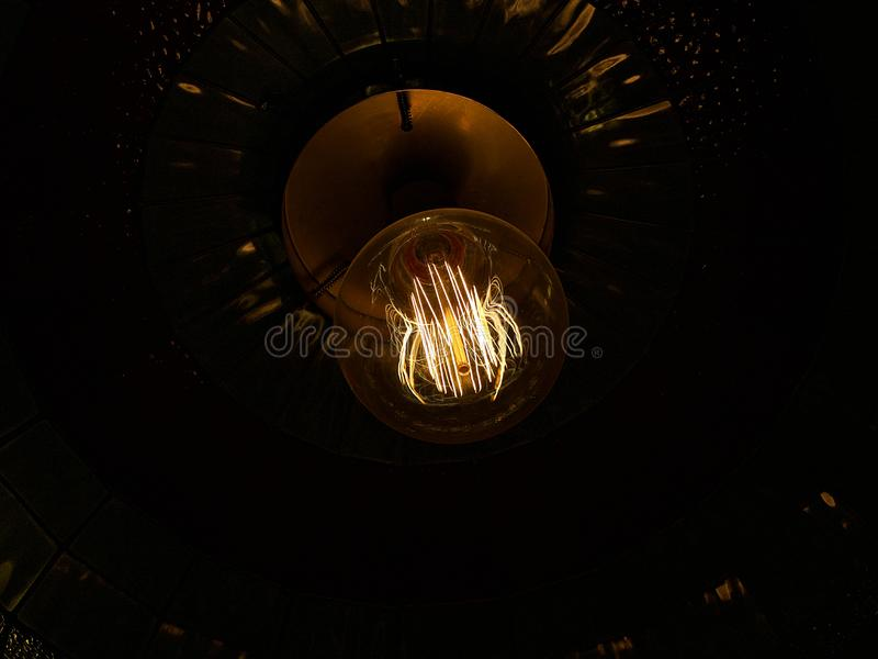 Lightbulb with dark background royalty free stock images