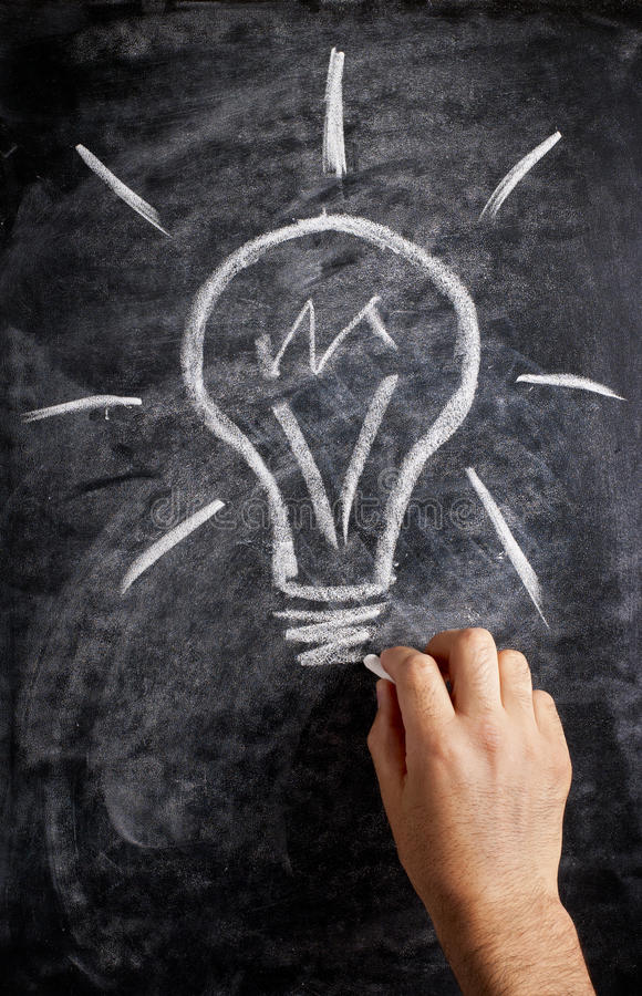 Lightbulb drawn on the blackboard stock image