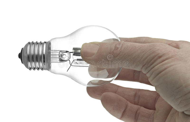 Lightbulb in a hand. Isolated on white background royalty free stock image