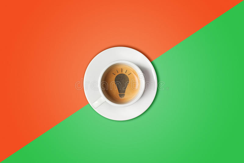 Lightbulb made in cup of coffee. Brain storm, idea concept or coffee-break. royalty free stock photos