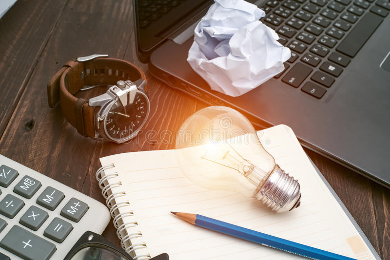 Lightbulb placed on notebook concept business idea. Lightbulb placed on notebook concept business idea stock image