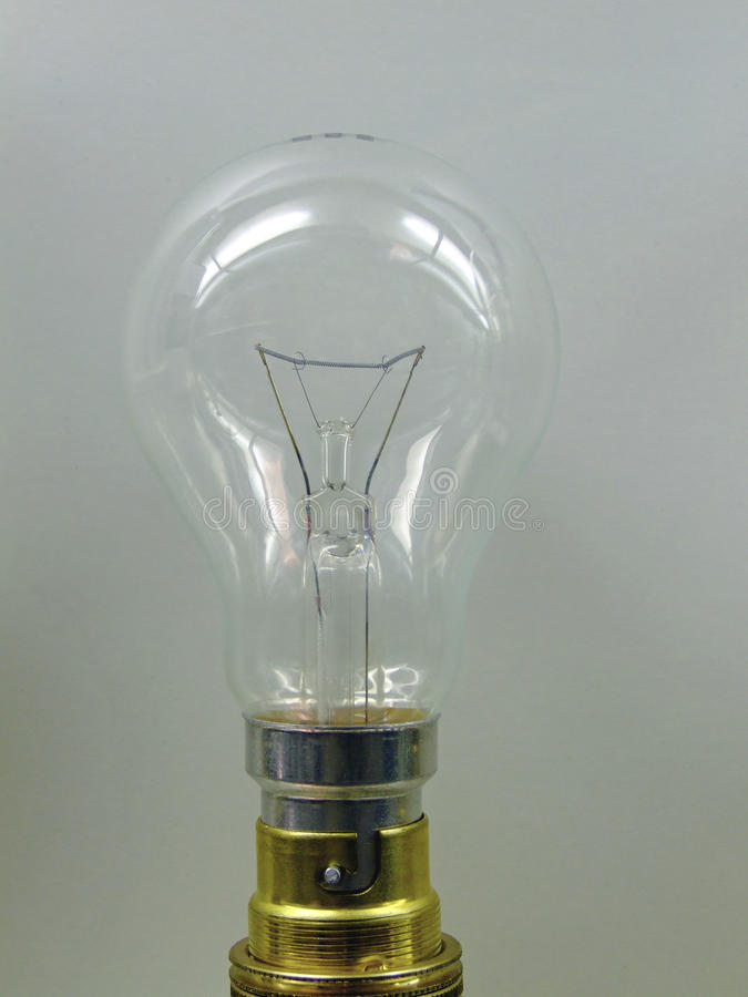 Lightbulb. Turned off incandescent light bulb with bayonet fixture royalty free stock photos
