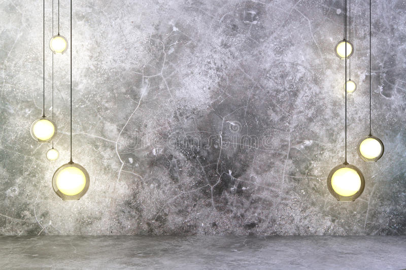 Lightbulbs with concrete wall and floor royalty free stock image