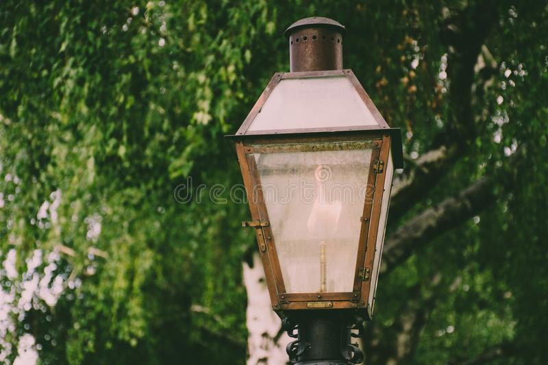 Lighted Brown Metal Post Lamp royalty free stock image