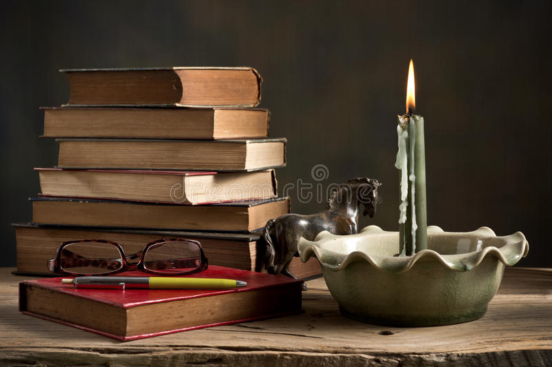Lighted candle and old books stock image image of book reference download lighted candle and old books stock image image of book reference 39759483 ccuart Images