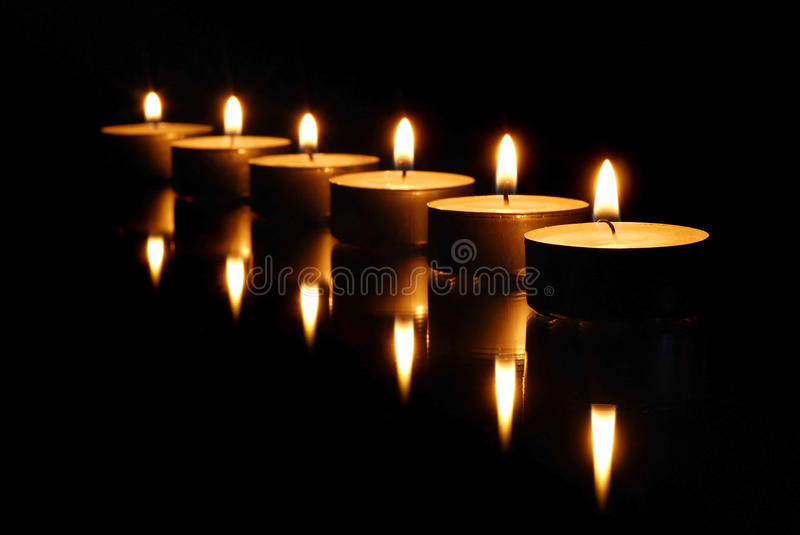 Lighted candles royalty free stock photography