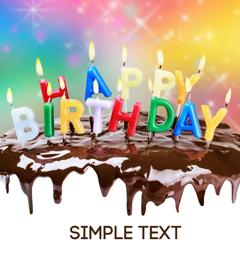Lighted candles on a birthday cake. Bottom white space for text or congratulations. text font from open sources, free license of use royalty free stock photography