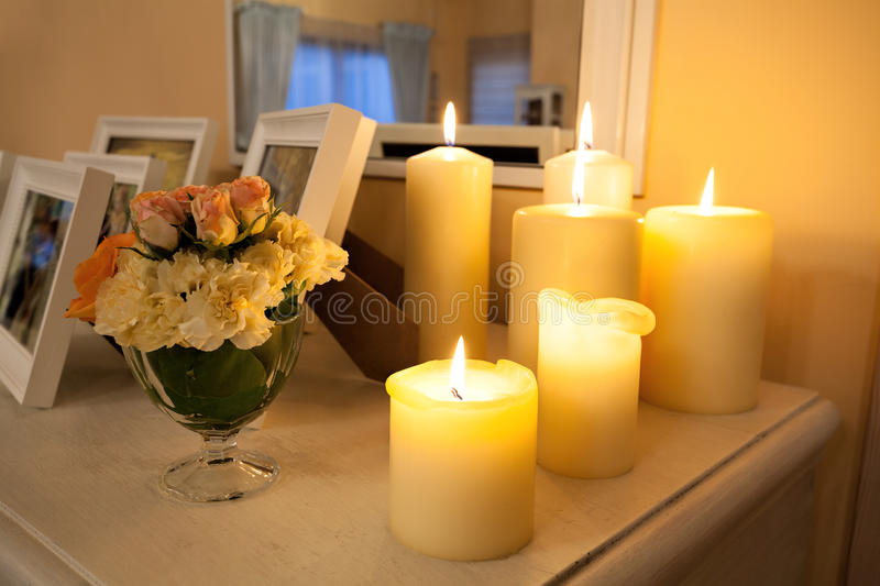 Lighted candles. Closeup of a lighted candles on white commode stock photo