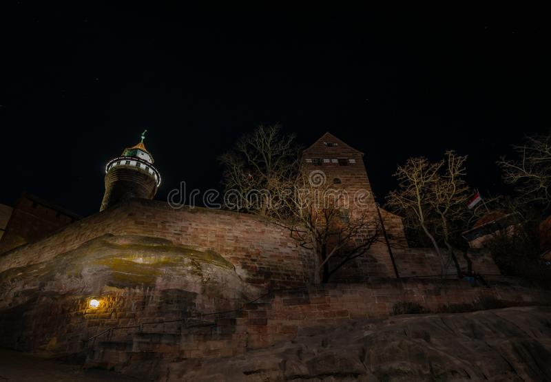 Lighted castle at the night. The Castle is build on a big rock stock image