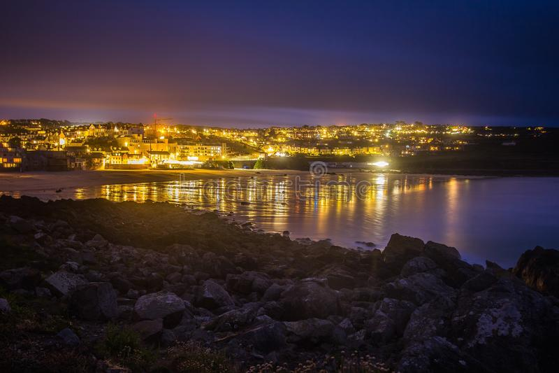 Lighted City in Distance Near Body of Water royalty free stock photo