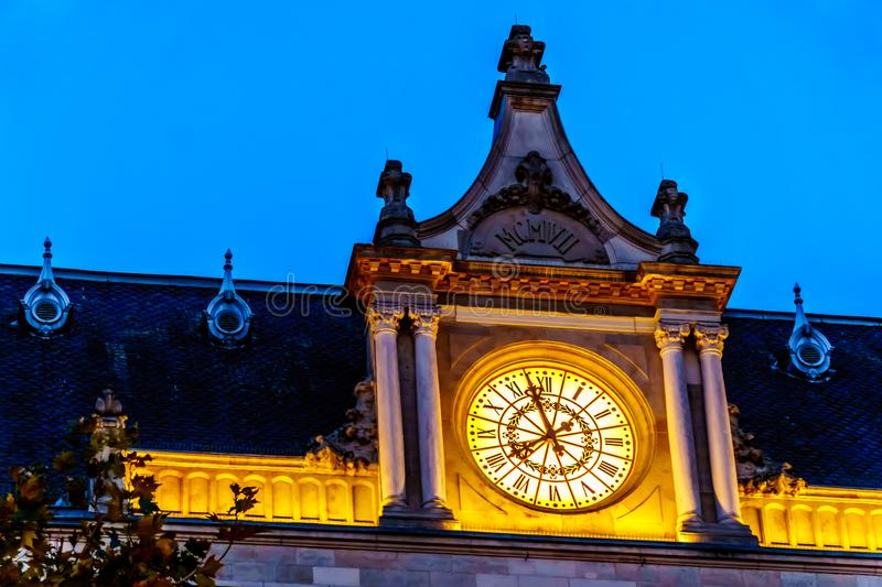 The lighted clock of Cercle Cité Luxembourg at night stock photo