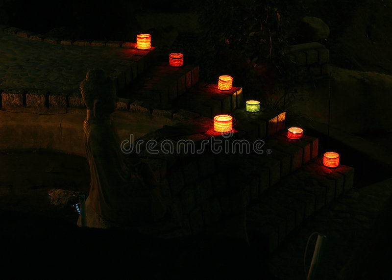 Download Lighted Colored Lamps And Candles With Buddha Stock Image - Image: 6801217