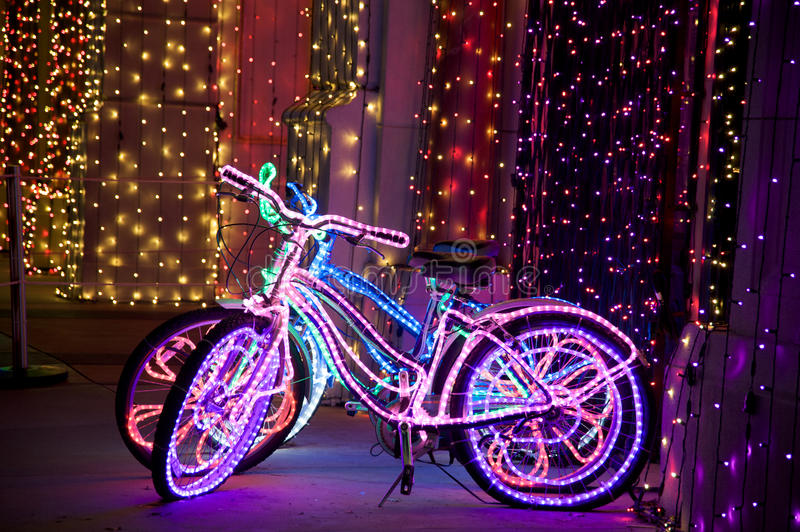 Lighted funky bicycles stock photography