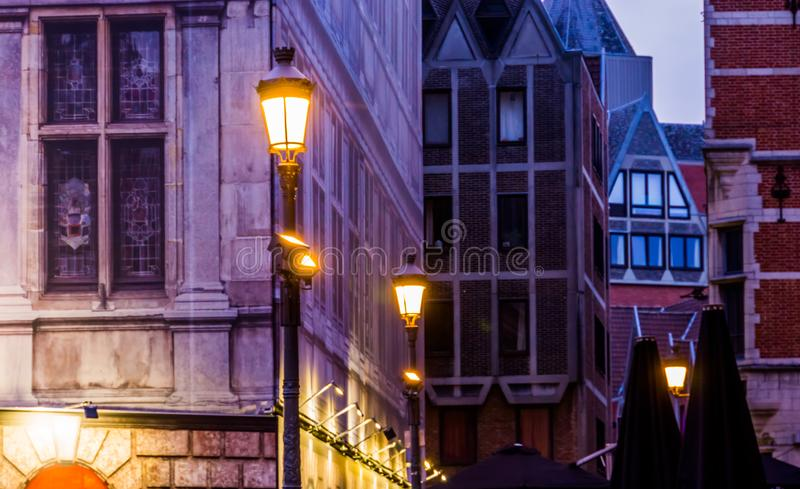 Lighted lampposts with old classical architecture, The city of antwerp by night, Antwerpen, Belgium. Some lighted lampposts with old classical architecture, The stock photography