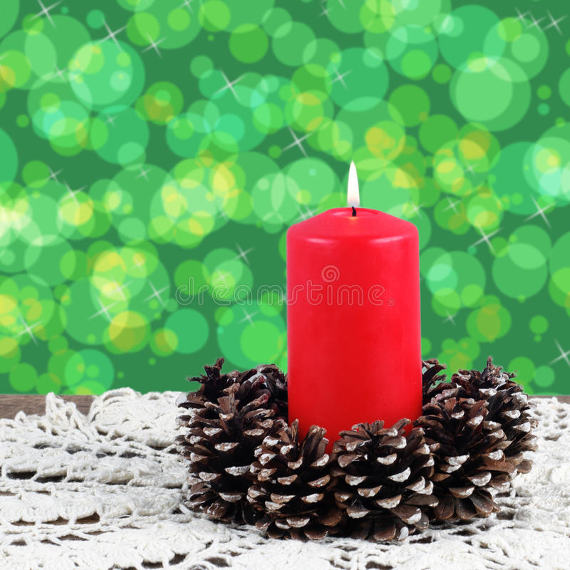 Lighted Red Candle Stock Photography