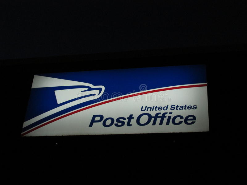 Lighted sign of United States Postal Service in Edison, NJ USA. White, red and blue lighted sign of USPS in Edison, NJ USA. 04/21/2015 royalty free stock photo