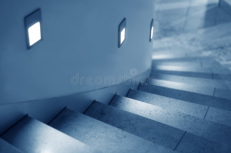Lighted Stairway. Lighted curved stairway stock photos
