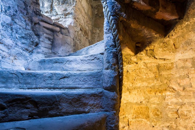 Lighted stone staircase in a medieval castle stock photos
