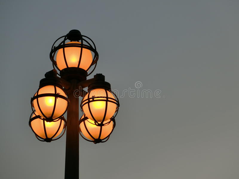 Lighted Street Lights. Against the evening sky. These street lights were found along the Singapore River stock photography