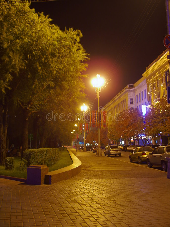 Lighted street at night. View of a lighted street in Volgograd at night stock images