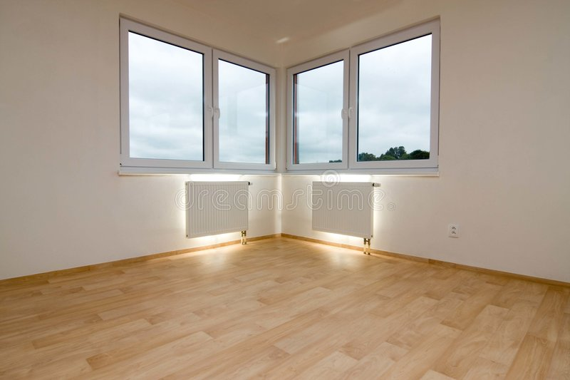 Lighted wall radiators. Two lighted wall radiators under windows in an empty room royalty free stock photo