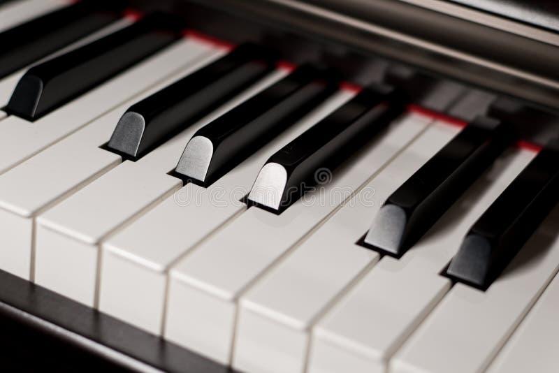 Accoustic piano keys detail. Lightened accoustic piano keys detail royalty free stock photography